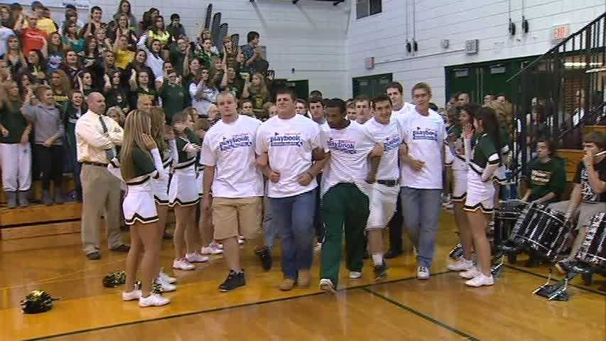 Manny Simpson helps lead the Penn-Trafford football team into the gymnasium