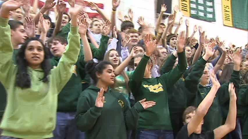The Penn-Trafford students sing along and wave their hands to the school's alma mater