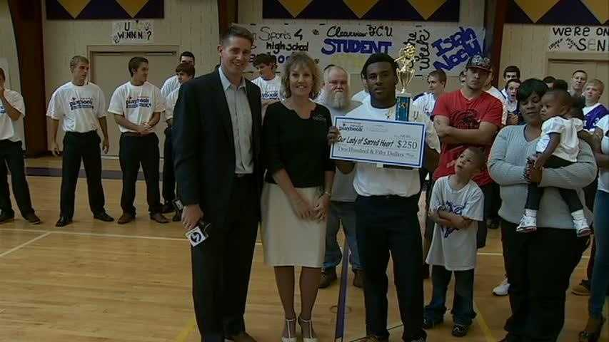 Clearview Federal Credit Union presented a check to Our Lady of Sacred Heart for $250 on behalf of Isiah Neely