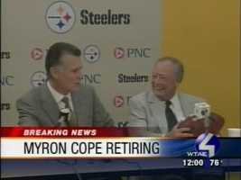 Myron Cope receives a game ball from Steelers President Art Rooney II during the retirement press conference.
