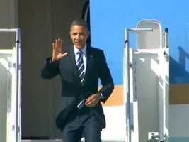 President Barack Obama deplanes Air Force One