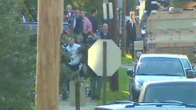Police arrest Frank Perez Jr. (white shirt) in Verona.