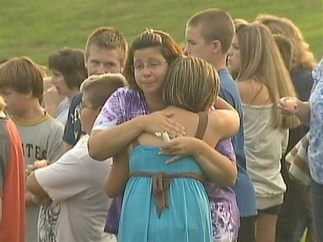 More than 100 people gathered at Center Elementary School in Plum to remember two local girls killed in a flash flood in Highland Park.