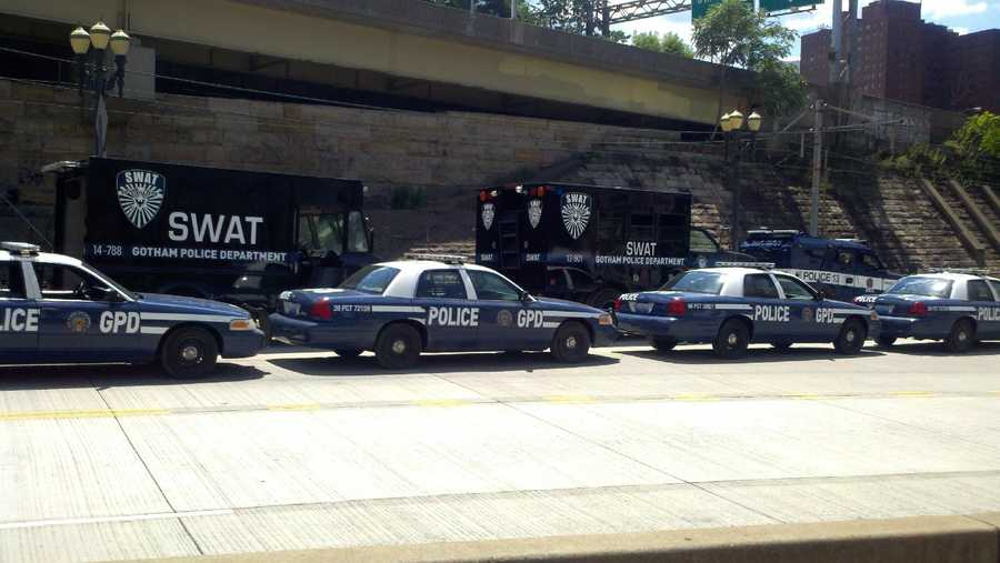 Gotham Police Department cars lined up for a scene at the downtown entrance to the Port Authority's Martin Luther King Jr. East Busway.