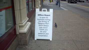 "Some stores on Smithfield Street posted signs to let people know they were open during filming of ""The Dark Knight Rises."" The working title of the movie was ""Magnus Rex."""
