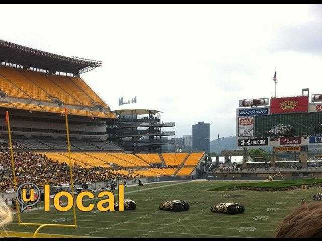 "A u local member's photo of ""Tumbler"" Batmobiles on the playing surface at Heinz Field during the filming of ""The Dark Knight Rises."""
