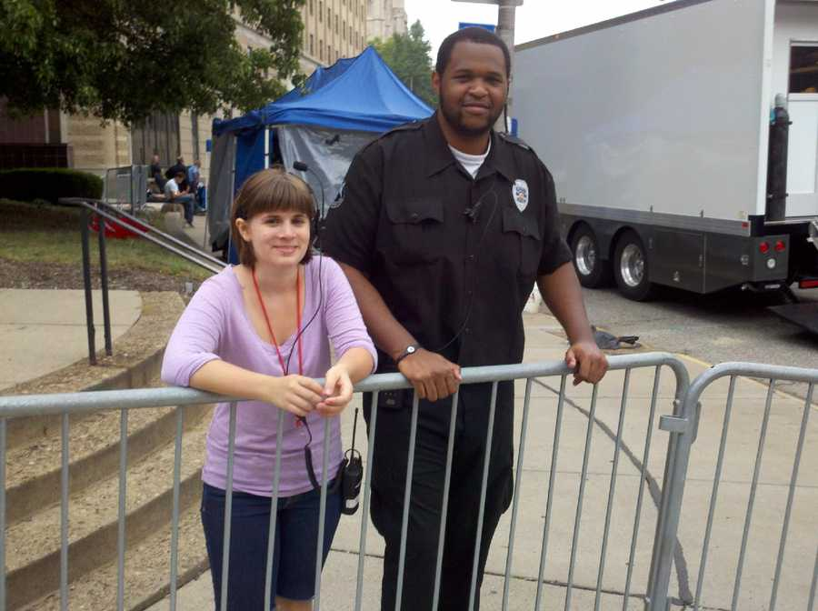 "A production assistant and a security guard on the perimeter of ""The Dark Knight Rises"" movie set at Software Engineering Institute in Oakland."