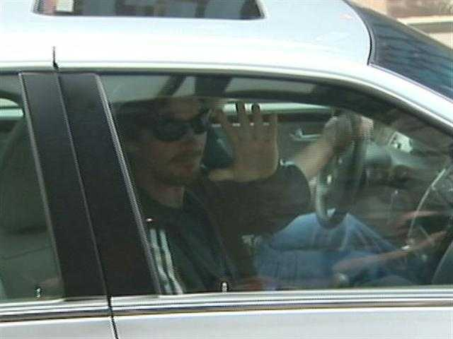 "Christian Bale waves to a WTAE camera while leaving the news conference for ""The Dark Knight Rises"" at the Renaissance Hotel."