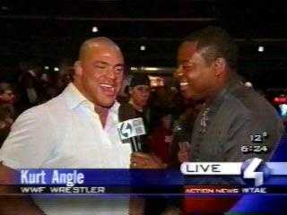 """WTAE Channel 4's Andrew Stockey interviewed Kurt Angle during the """"Wing Bowl"""" at the Sports Rock Cafe in January 2004."""