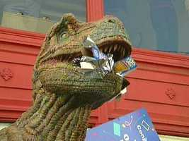 The dinosaur statue at the Art Institute of Pittsburgh chows down on Pop-Tarts.