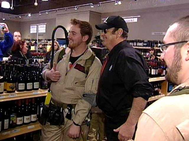 "Dan Aykroyd poses for a picture with a fellow ""Ghostbuster"""