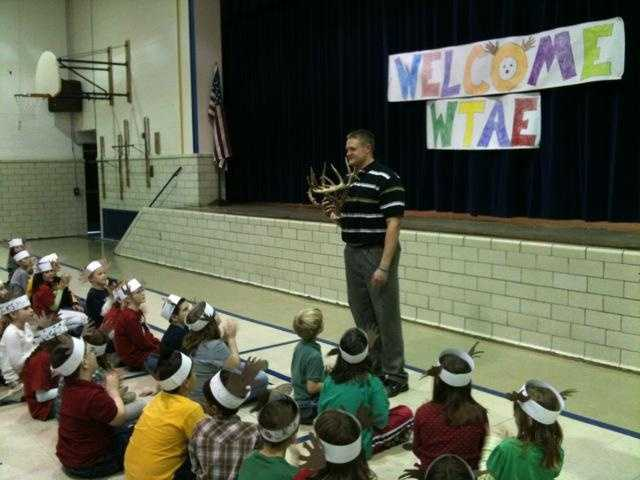 Steve McCartney,  fourth-grade teacher at Washington Elementary School, teaches a gun safety lesson using the 43-point buck that he shot.