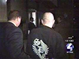 The boxer (pictured, right) was arrested near his Moon Township home and taken to Allegheny County Jail in handcuffs.
