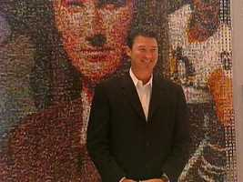 Penguins owner Mario Lemieux stands in front of the Mario Mosaic at Consol Energy Center