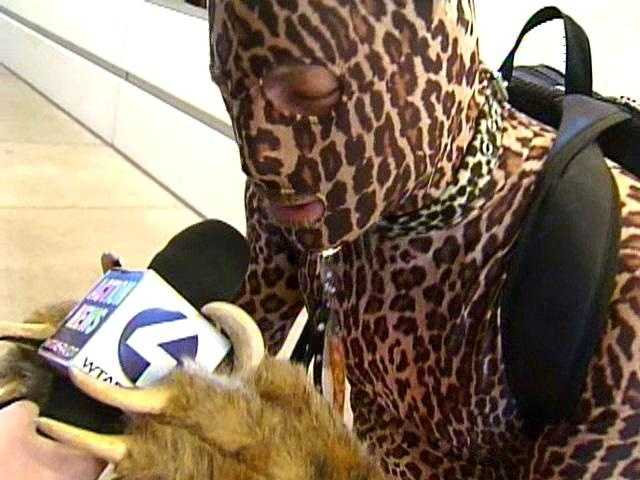 A furry plays with a WTAE news microphone.