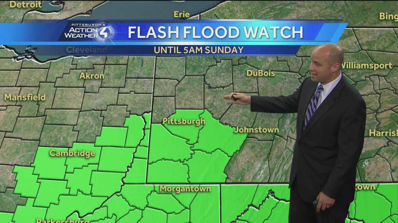 The areas covered by a flash flood watch are highlighted in green.