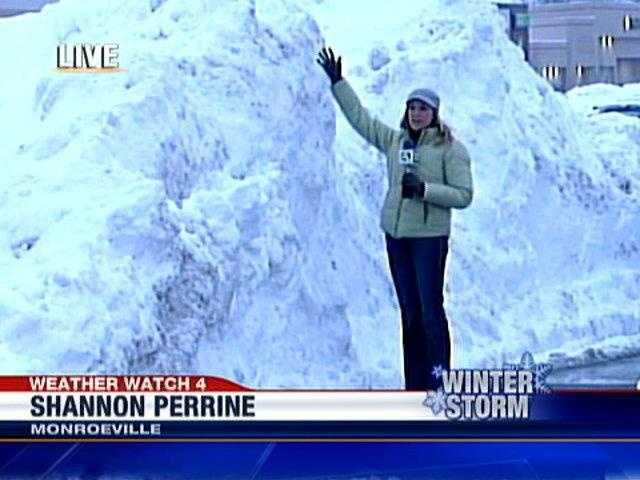 Shannon Perrine stands next to a snow pile in the Monroeville Mall parking lot.