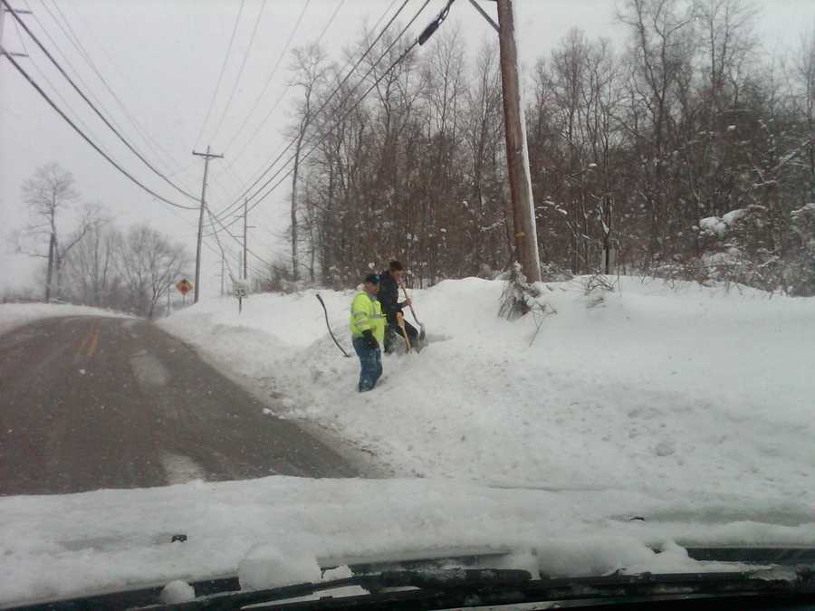 Crews work to clear snow on the side of New Texas Road in Plum.