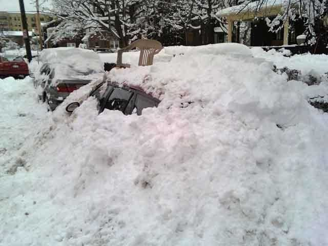 A car is buried in snow in Squirrel Hill in Pittsburgh.