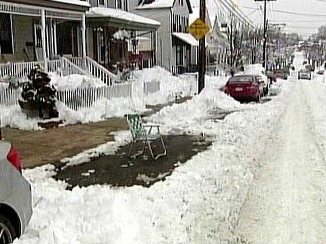 Someone placed a chair in the street to save a parking space after a snowstorm.