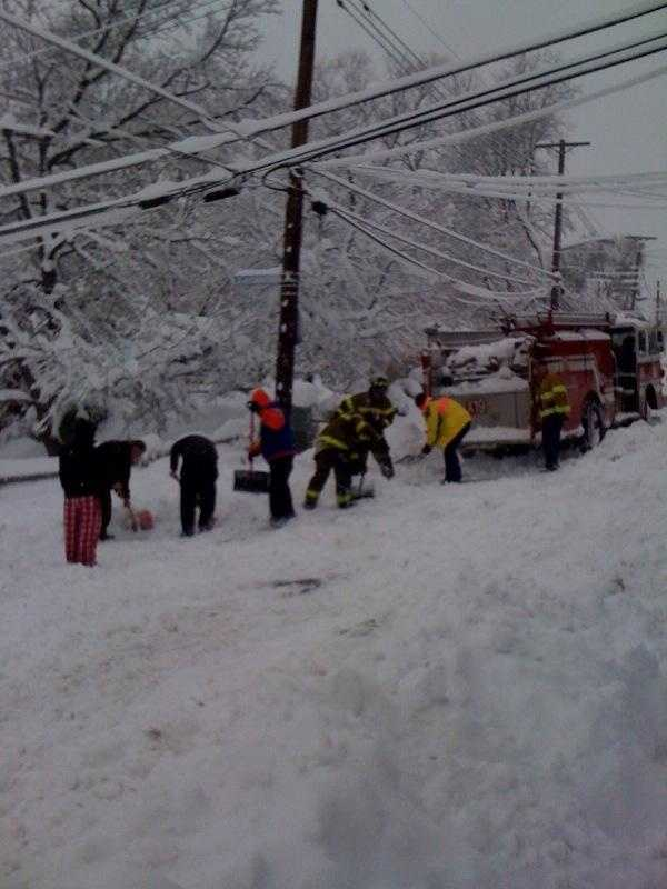 Neighbors help push a fire truck out of snow in Beechview.