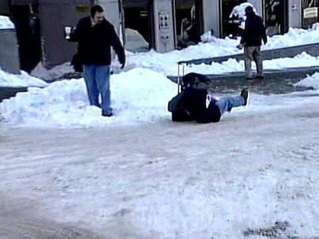 A man slips and falls near the corner of William Penn Place and Oliver Avenue in downtown Pittsburgh.