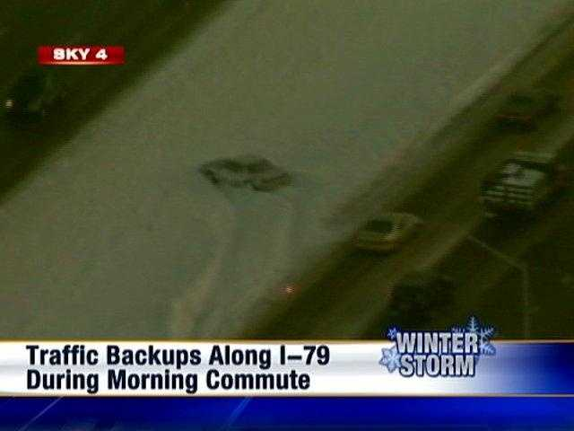 A car gets stuck in snow on Interstate 79.