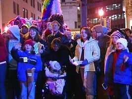 Families gather to watch the parade that's part of Pittsburgh's First Night celebrations.