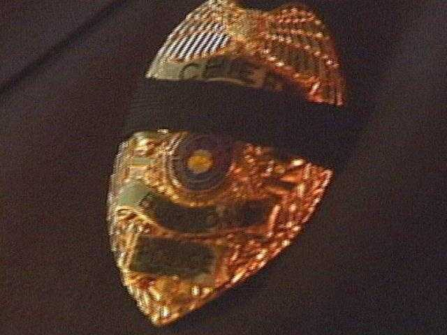 Penn Hills Police Chief Howard Burton wears a black band over his badge, honoring slain officer Michael Crawshaw