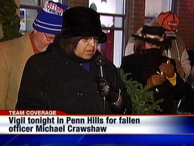 Mourners join in prayer at a candlelight vigil in Penn Hills for fallen police officer Michael Crawshaw