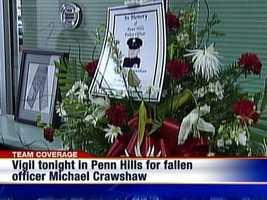 A flower arrangement to honor fallen Penn Hills police officer Michael Crawshaw