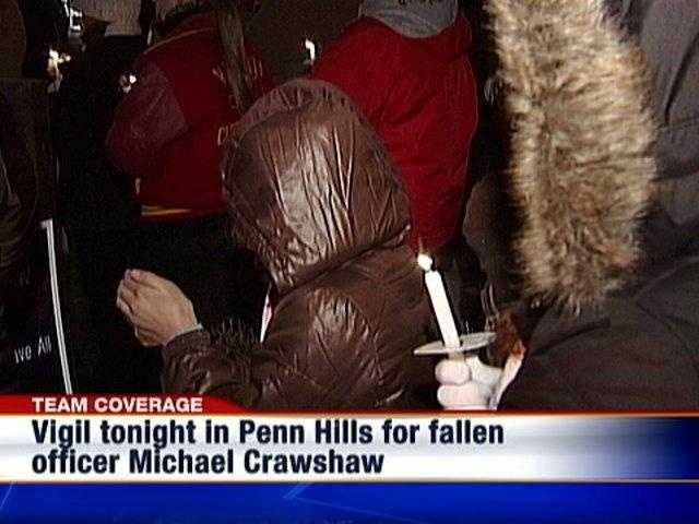 Mourners gather for a candlelight vigil in Penn Hills for fallen Officer Michael Crawshaw