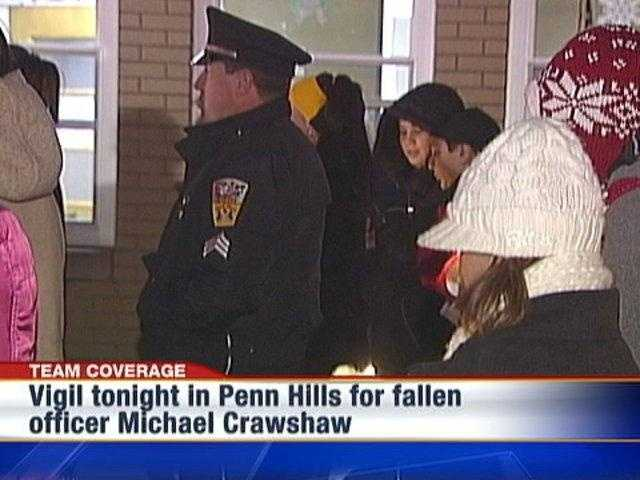 Mourners gather for a candlelight vigil in Penn Hills for fallen police officer Michael Crawshaw