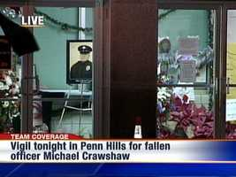 A memorial site for Penn Hills police officer Michael Crawshaw, who was killed in the line of duty