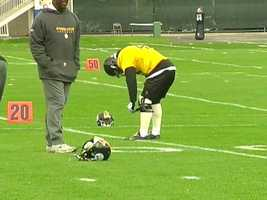 Troy Polamalu adjusts the brace on his injured left knee.