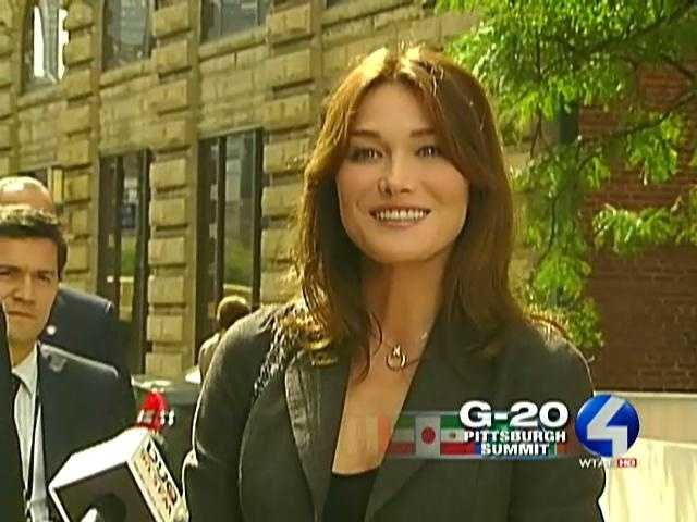Carla Bruni-Sarkozy, wife of French president Nicolas Sarkozy, talks to reporters outside the Warhol Museum.