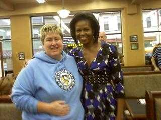 First Lady Michelle Obama poses with customer Gina Manella at Pamela's Diner in Millvale. Obama is a fan of the pancakes there.