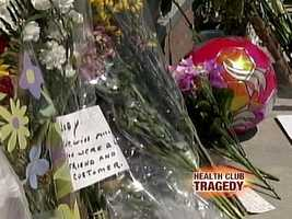 A memorial to the victims grew as people left flowers and cards outside the gym.