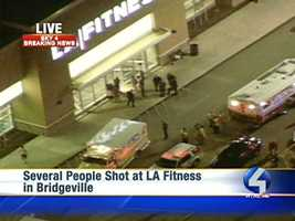 """Witnesses told police the lights went out in a dance class and the gunman opened fire, creating """"flashes in the dark."""""""