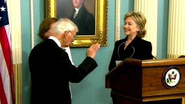 Secretary of State Hillary Rodham Clinton swears Dan Rooney in as U.S. ambassador to Ireland.