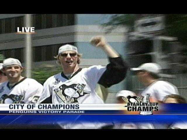 Penguins forward Jordan Staal salutes the crowd along Grant Street.