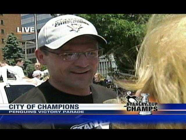 Coach Dan Bylsma has plenty to smile about as he speaks with WTAE's Sally Wiggin at the Penguins' victory parade.