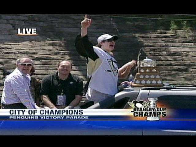 Evgeni Malkin cheers as he travels with the Conn Smythe trophy down the parade route.