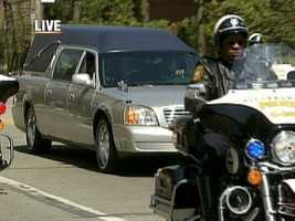 The police procession for Pittsburgh's fallen officers drives through Oakland.