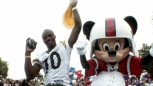 Super Bowl XLIII MVP Santonio Holmes at the traditional Walt Disney World parade.
