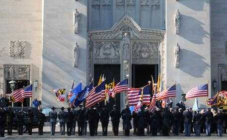 Mourners remembered Sam Hicks at his funeral in Baltimore, where he worked as a police officer before joining the FBI.