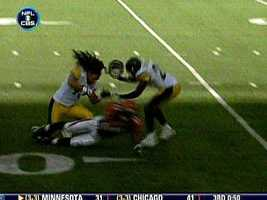 Troy Polamalu's helmet flies off while he hits Cincinnati running back Cedric Benson.