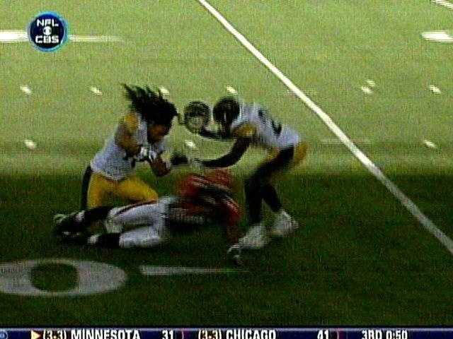 Troy Polamalu's helmet flies off while he hits Cincinnati running back Cedric Benson.