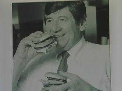 A photo of Big Mac inventor Jim Delligatti eating one of the earliest Big Macs.