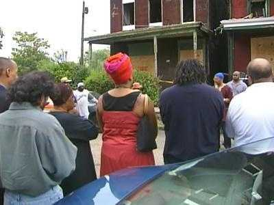 Friends and neighbors gathered outside the house on Winslow Street for a noontime vigil to remember the dead children.